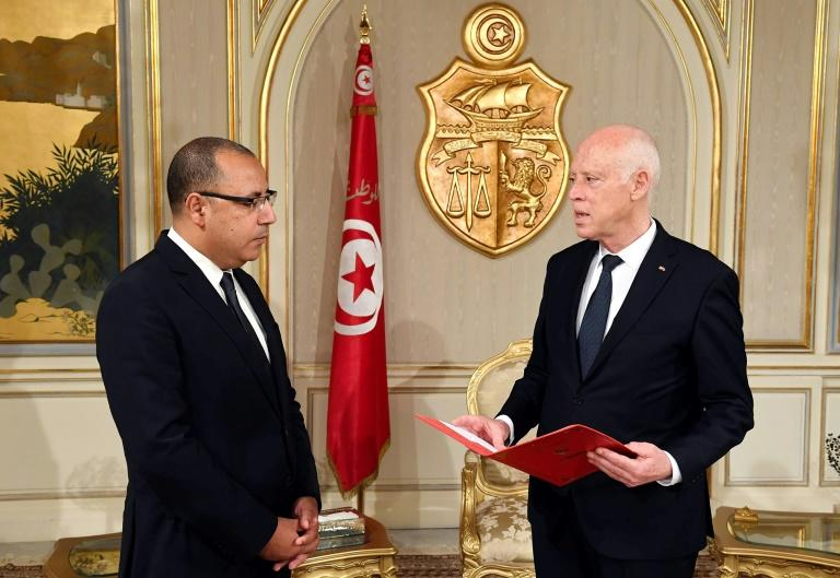 Tunisian President Kais Saied (R) appoints Interior Minister Hichem Mechichi as the country's new prime minister, tasked with forming a new unity cabinet, at  Carthage Palace