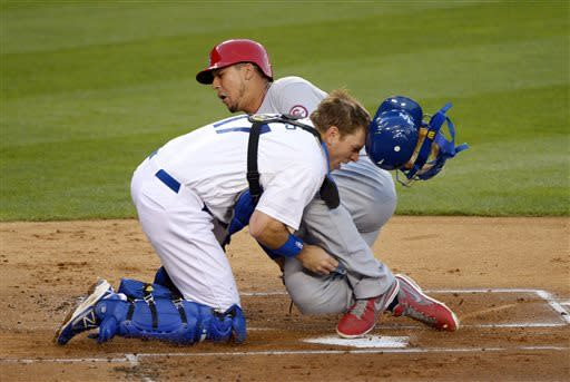 St. Louis Cardinals' Jon Jay, top, collides with Los Angeles Dodgers catcher A.J. Ellis while scoring on a double by David Freese during the second inning of their baseball game on Friday, May 24, 2013, in Los Angeles. (AP Photo/Mark J. Terrill)