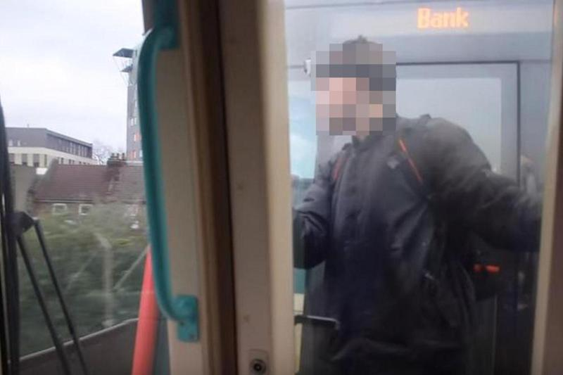 Reckless stunt: The YouTuber travelled in between the carriages of a moving DLR train (YouTube / Trikkstar)