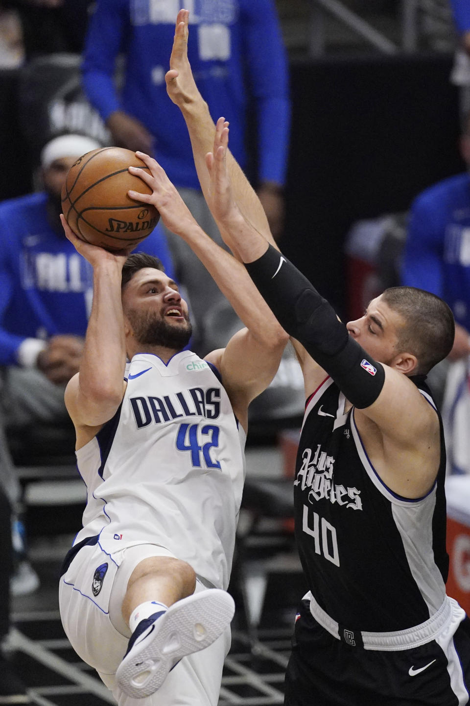 Dallas Mavericks forward Maxi Kleber, left, shoots as Los Angeles Clippers center Ivica Zubac defends during the first half in Game 1 of an NBA basketball first-round playoff series Saturday, May 22, 2021, in Los Angeles. (AP Photo/Mark J. Terrill)