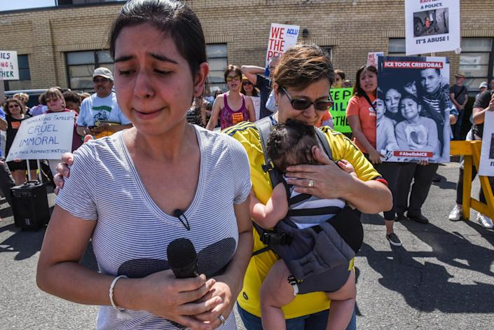<p>Sharon Chajon, whose husband is a detained immigrant, cries as people participate in a protest against recent U.S. immigration policy of separating children from their families when they enter the United States as undocumented immigrants, in front of a Homeland Security facility in Elizabeth, N.J., June 17, 2018. (Photo: Stephanie Keith/Reuters) </p>