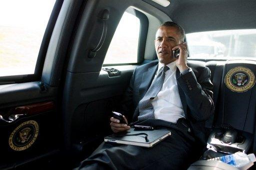 US President Barack Obama talking on the phone with Aurora Mayor Steve Hogan during the motorcade ride to Palm Beach International Airport in Palm Beach, Florida, on July 20, in a picture provided by the White House. Obama called Mayor Hogan to offer his condolences and support to the Aurora community following the shocking shooting at a movie theater that left 12 people dead and nearly 60 hurt