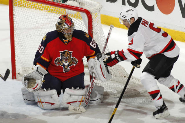 SUNRISE, FL - APRIL 21: Goaltender Jose Theodore #60 of the Florida Panthers defends the net as Zach Parise #9 of the New Jersey Devils hits the puck with his hand in front of the net in Game Five of the Eastern Conference Quarterfinals during the 2012 NHL Stanley Cup Playoffs at the BankAtlantic Center on April 21, 2012 in Sunrise, Florida. The Panthers defeated the Devils 3-0. (Photo by Joel Auerbach/Getty Images)