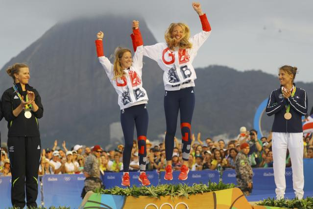 2016 Rio Olympics - Sailing - Victory Ceremony - Women's Two Person Dinghy - 470 - Victory Ceremony - Marina de Gloria - Rio de Janeiro, Brazil - 18/08/2016. Gold medalists Hannah Mills (GBR) of Britain and Saskia Clark (GBR) of Britain celebrate on the podium. REUTERS/Brian Snyder FOR EDITORIAL USE ONLY. NOT FOR SALE FOR MARKETING OR ADVERTISING CAMPAIGNS.