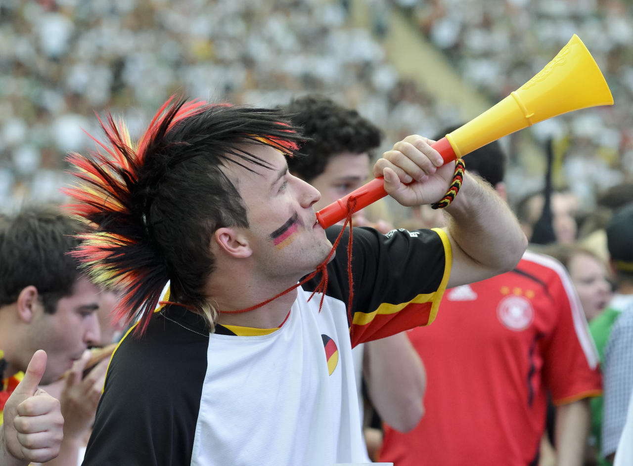 A fan of the German team blows in a vuvuzela while he watches the Euro 2012 football championships semi-final match Germany vs Italy at the Olympiastadion in Munich, southern Germany, on June 28, 2012. The semi-final was played in Warsaw, Poland.   AFP PHOTO / GUENTER SCHIFFMANNGUENTER SCHIFFMANN/AFP/GettyImages