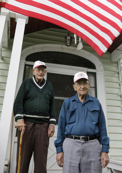 In this Wednesday, May 22, 2013 photo, World War II veterans Bob Addison, left, and Jerry West pose for a photo in Glens Falls, N.Y. Addison and West share more than a longtime friendship. They share some of the same memories of bloody battles fought on Pacific islands while serving with an elite Marine Corps unit that was the forerunnner of today's U.S. Special Forces. Living just miles apart, the two men are among the last surviving members of the original Marine Raider battalions that were the first American ground troops to attack Japanese-held territory. (AP Photo/Mike Groll)