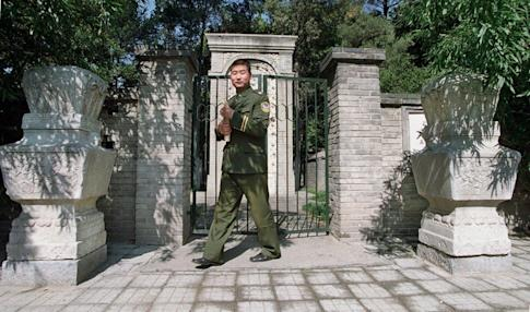 A security guard at the entrance to the tomb of the Jesuit missionary Matteo Ricci, now on the grounds of the Beijing Administrative College, formerly the Chinese Communist Party School in Beijing. Photo: SCMP Pictures
