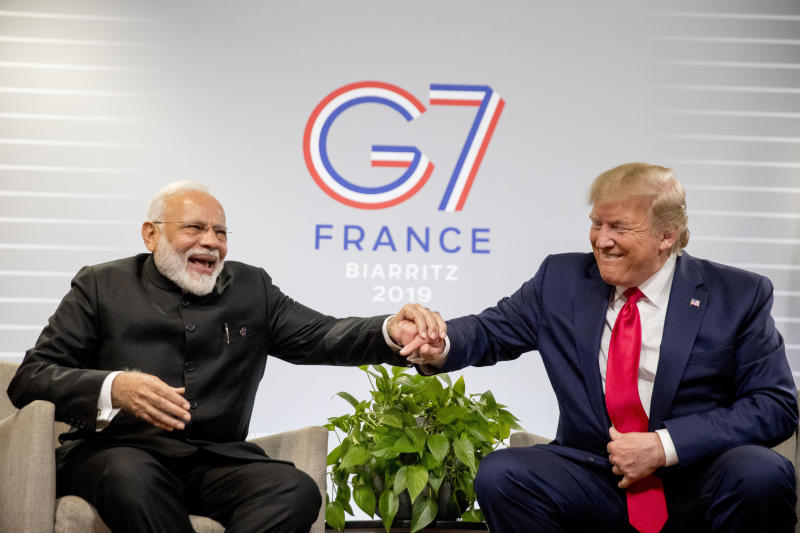 President Donald Trump and Indian Prime Minister Narendra Modi share a laugh together during a bilateral meeting at the G-7 summit in Biarritz, France, Monday, Aug. 26, 2019. (AP Photo/Andrew Harnik)