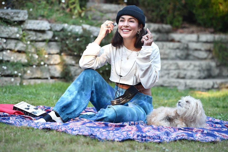 <p>Vanessa Hudgens hangs out in the park with her pup on Thursday in L.A. </p>