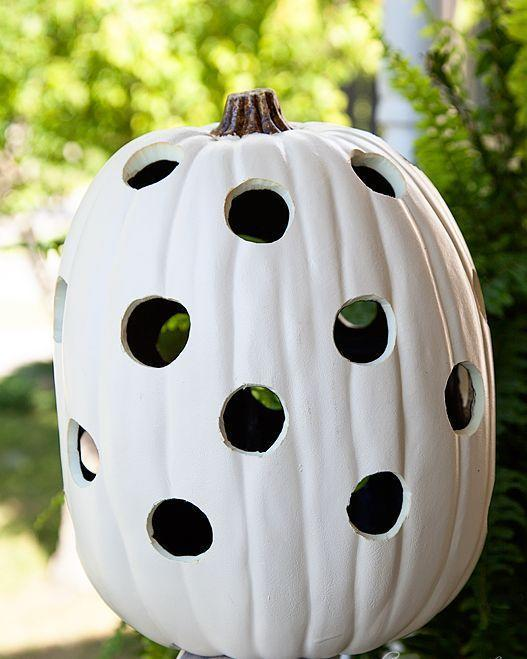 """<p>This blogger used a professional """"hot knife"""" to cut out the round, precise holes on the pumpkin you see here, but you can achieve a similar look with traditional carving tools. </p><p><strong>Get the tutorial at <a href=""""https://whipperberry.com/black-white-halloween-pumpkins-for-the-great-pumpkin-challenge/"""" rel=""""nofollow noopener"""" target=""""_blank"""" data-ylk=""""slk:Whipperberry"""" class=""""link rapid-noclick-resp"""">Whipperberry</a>.</strong></p><p><strong><a class=""""link rapid-noclick-resp"""" href=""""https://go.redirectingat.com?id=74968X1596630&url=https%3A%2F%2Fwww.michaels.com%2Fwalnut-hollow-professional-hotknife%2F10389558.html&sref=https%3A%2F%2Fwww.thepioneerwoman.com%2Fhome-lifestyle%2Fcrafts-diy%2Fg36982763%2Fpumpkin-carving-ideas%2F"""" rel=""""nofollow noopener"""" target=""""_blank"""" data-ylk=""""slk:SHOP HOT KNIVES"""">SHOP HOT KNIVES</a><br></strong></p>"""
