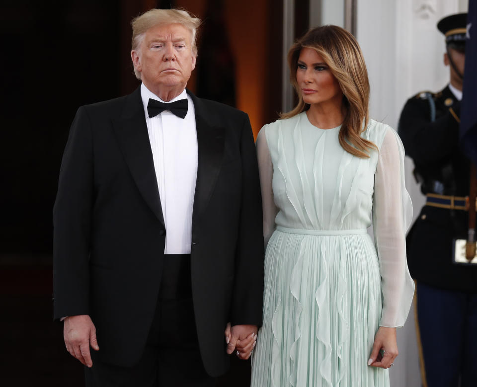 President Donald Trump and first lady Melania Trump wait to welcome Australian Prime Minister Scott Morrison and his wife Jenny Morrison as they arrive for a State Dinner at the White House, Friday, Sept. 20, 2019, in Washington. (AP Photo/Alex Brandon)