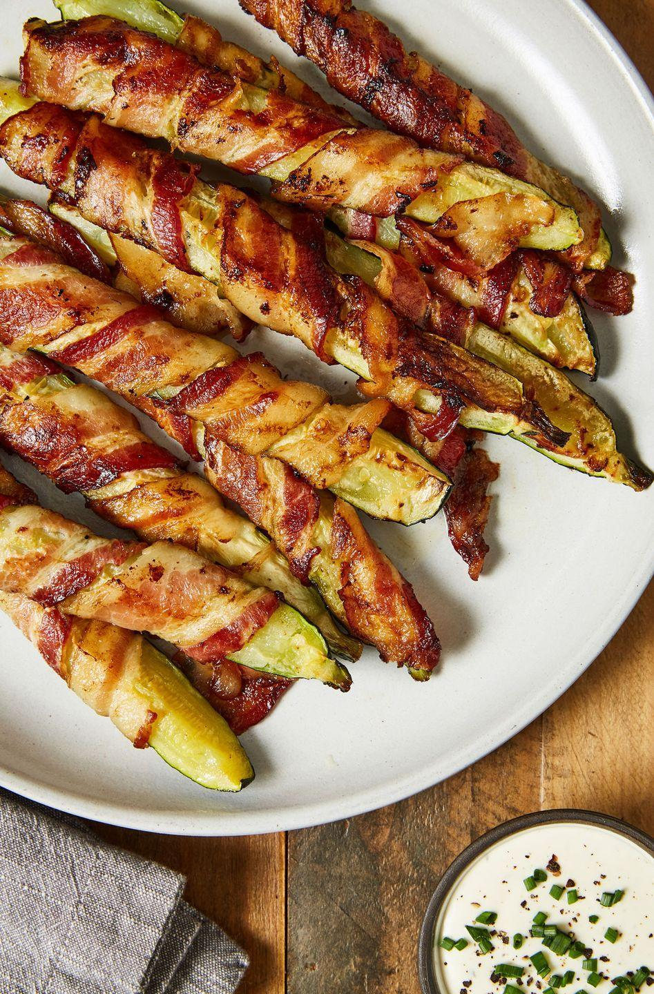 """<p>Bacon-wrapped anything, please!</p><p>Get the recipe from <a href=""""https://www.delish.com/cooking/recipe-ideas/a22575410/bacon-zucchini-fries-recipe/"""" rel=""""nofollow noopener"""" target=""""_blank"""" data-ylk=""""slk:Delish"""" class=""""link rapid-noclick-resp"""">Delish</a>.</p>"""
