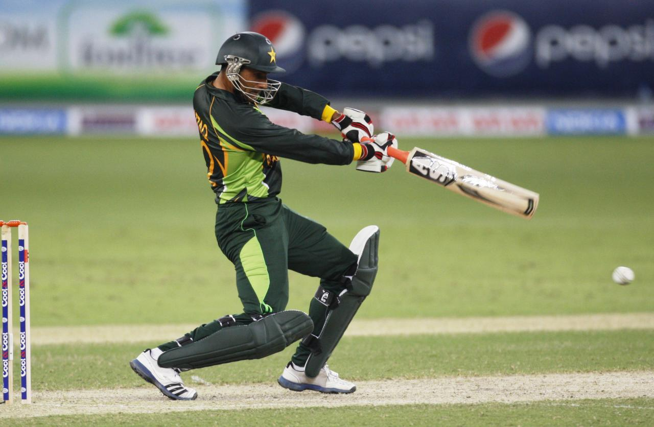 Pakistan's Abdul Razzaq plays a shot during their first Twenty20 international cricket match against South Africa in Dubai November 13, 2013. REUTERS/Nikhil Monteiro (UNITED ARAB EMIRATES - Tags: SPORT CRICKET)
