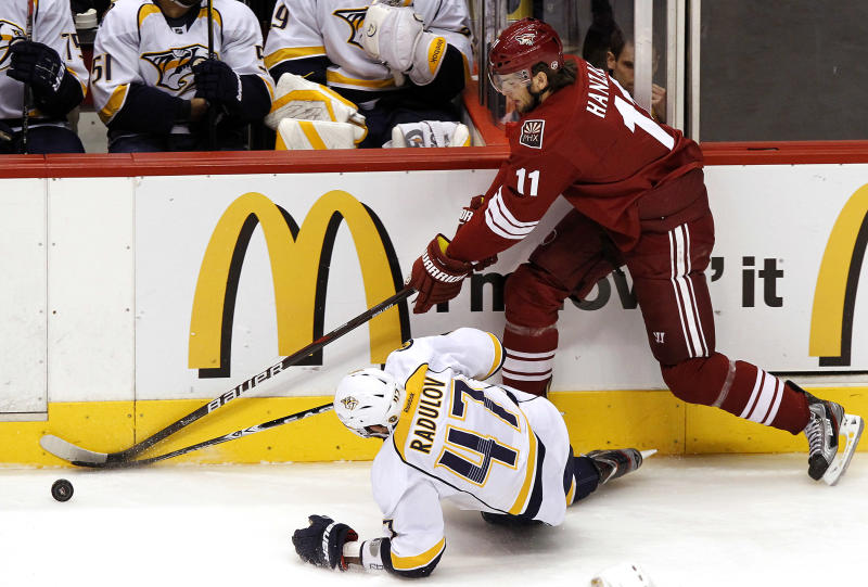 Phoenix Coyotes' Martin Hanzal (11), of the Czech Republic, works against Nashville Predators' Alexander Radulov (47), of Russia, for the puck in the first period during Game 5 in an NHL hockey Stanley Cup Western Conference semifinal playoff series Monday, May 7, 2012, in Glendale, Ariz. (AP Photo/Ross D. Franklin)