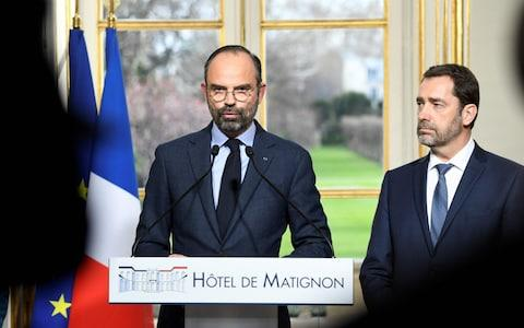 French Prime Minister Edouard Philippe (L) gives a press conference next to French Interior Minister Christophe Castaner, on March 18, 2019 at the Matignon hotel in Paris, to announce measures after weekend riots. - Credit:  BERTRAND GUAY/AFP