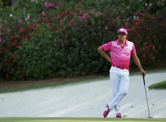 U.S. golfer Rickie Fowler waits to putt on the 13th green during the second round of the Masters golf tournament at the Augusta National Golf Club in Augusta, Georgia April 11, 2014. REUTERS/Mike Blake (UNITED STATES - Tags: SPORT GOLF)