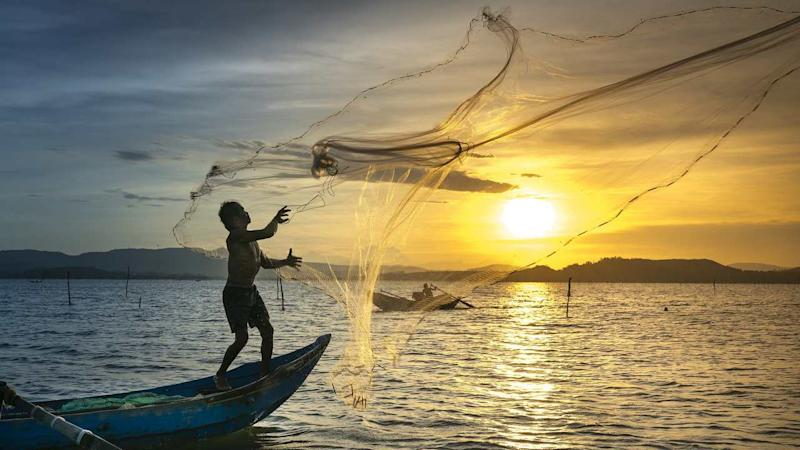 Fishermen casting their nets at sunset. image credit: Pixabay