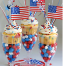 """<p>Get ready to party! Serve these sprinkle-studded cupcakes in plastic wine glasses filled with candy for a truly festive feel.</p><p><strong>Get the recipe at <a href=""""https://www.livinglocurto.com/red-white-blue-funfetti-cupcakes/"""" rel=""""nofollow noopener"""" target=""""_blank"""" data-ylk=""""slk:Living Locurto"""" class=""""link rapid-noclick-resp"""">Living Locurto</a>.</strong></p><p><a class=""""link rapid-noclick-resp"""" href=""""https://go.redirectingat.com?id=74968X1596630&url=https%3A%2F%2Fwww.walmart.com%2Fsearch%2F%3Fquery%3Dplastic%2Bwine%2Bglasses&sref=https%3A%2F%2Fwww.thepioneerwoman.com%2Ffood-cooking%2Frecipes%2Fg36343624%2F4th-of-july-cupcakes%2F"""" rel=""""nofollow noopener"""" target=""""_blank"""" data-ylk=""""slk:SHOP PLASTIC WINE GLASSES"""">SHOP PLASTIC WINE GLASSES</a></p>"""