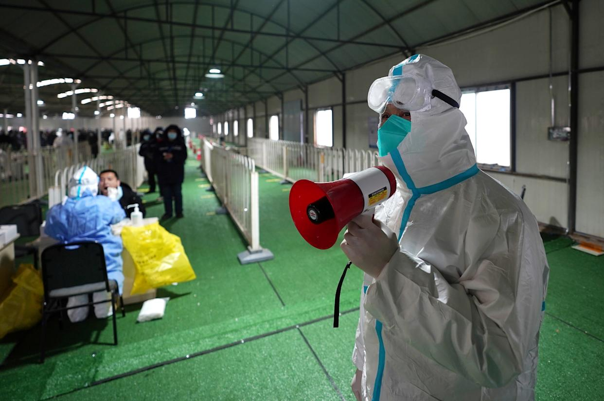 BEIJING, Jan. 26, 2021 -- A volenteer guides residents at a COVID-19 testing site in Daxing District of Beijing, capital of China, Jan. 26, 2021. Beijing started a second round of mass nucleic acid testing in Daxing District on Tuesday, in an effort to contain the latest COVID-19 resurgence. (Photo by Ju Huanzong/Xinhua via Getty) (Xinhua/Ju Huanzong via Getty Images)
