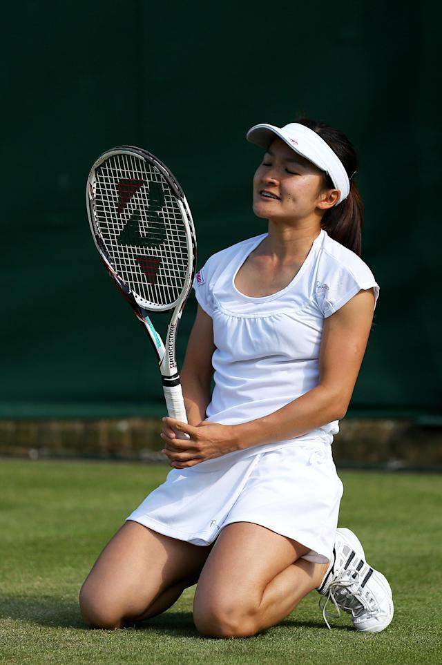 LONDON, ENGLAND - JUNE 29: Shuko Aoyama of Japan reacts during the Ladies' Doubles second round match between Shuko Aoyama of Japana dn Chanelle Scheepers of South africa and Raluca Olaru of Romania and Olga Savchuk of Ukraine on day six of the Wimbledon Lawn Tennis Championships at the All England Lawn Tennis and Croquet Club on June 29, 2013 in London, England. (Photo by Clive Brunskill/Getty Images)