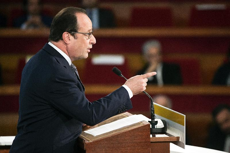 French President Francois Hollande delivers a speech during the opening of the Paris Summit of Conscience for the Climate, on July 21, 2015