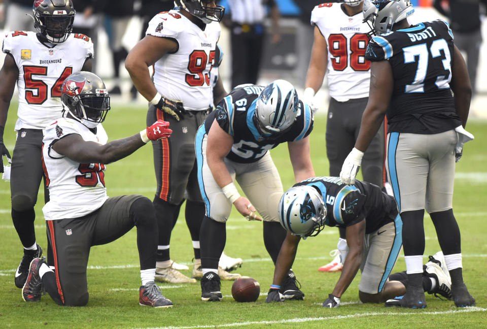 Tampa Bay Buccaneers outside linebacker Jason Pierre-Paul, left, celebrates his sack of Carolina Panthers quarterback Teddy Bridgewater, right, during fourth-quarter NFL football game action in Charlotte, N.C., Sunday, Nov. 15, 2020. (Jeff Siner/The Charlotte Observer via AP)