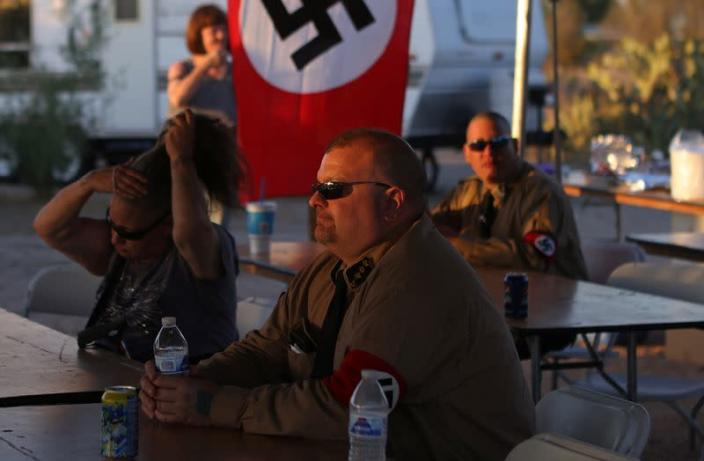 Burt Colucci of the white nationalist group National Socialist Movement attends a rally in Maricopa, Arizona
