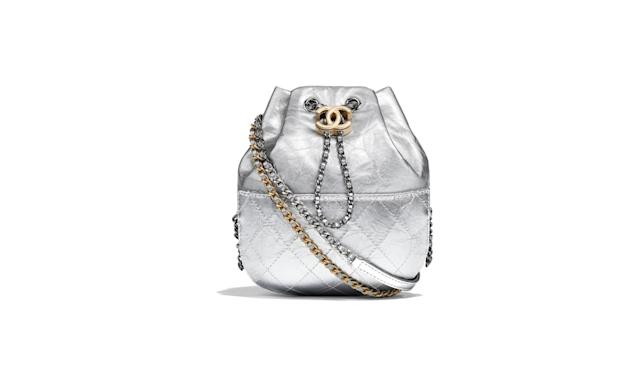 "<p>Gabrielle purse, $3,400, for retail information visit <a href=""http://www.chanel.com/en_US/fashion/products/handbags/g/s.-chanel-s-gabrielle-purse-metallic.17K.A98787Y8220745002.c.17K.html"" rel=""nofollow noopener"" target=""_blank"" data-ylk=""slk:chanel.com"" class=""link rapid-noclick-resp"">chanel.com</a> </p>"