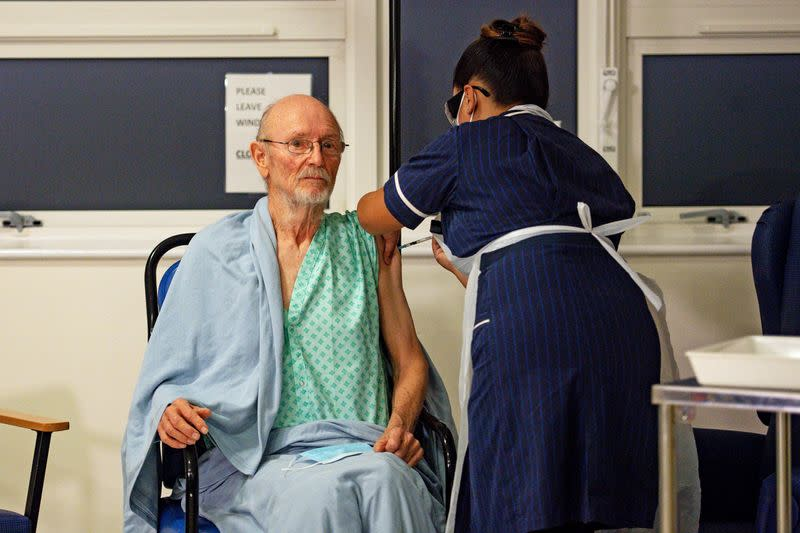 """FILE PHOTO: """"Bill"""" William Shakespeare, 81, receives the Pfizer/BioNTech COVID-19 vaccine at University Hospital in Coventry"""
