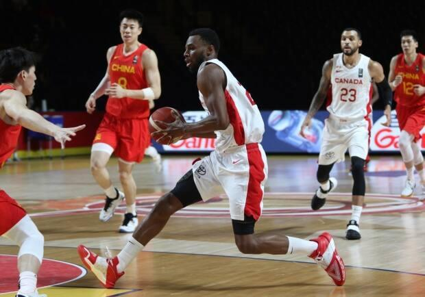 Canada's Andrew Wiggins drives to the basket during a 109-79 win over China on Wednesday at the FIBA Olympic qualifying tournament in Victoria, B.C. (Chad Hipolito/The Canadian Press - image credit)