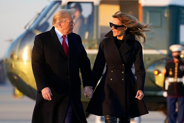<p>President Donald Trump and first lady Melania Trump walk to board Air Force One at Andrews Air Force Base, Md., Wednesday to travel to Mar-a-Lago</p> (AP)