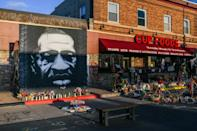 A mural and memorial to George Floyd at the Minneapolis intersection where he died