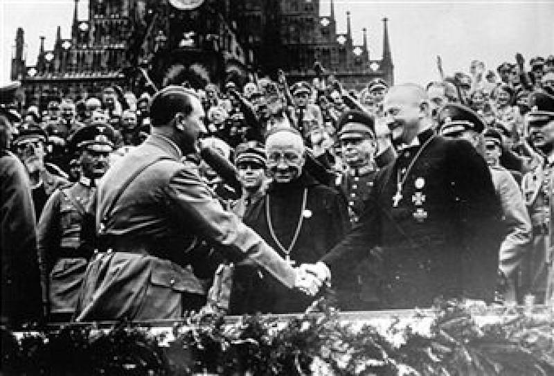 GERMANY - SEPTEMBER 08: Adolf Hitler shakes the hand of the bishop Ludwig Muller during the National Socialist Congress held in Nuremberg in 1934 - Date of Photo: 8 Settembre 1934 (Photo by Societe' du Petit Parisien Dupuy & C.ie, Paris/Alinari via Getty Images)