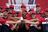Team USA players and captains pose with the trophy after the Ryder Cup matches at the Whistling Straits Golf Course Sunday, Sept. 26, 2021, in Sheboygan, Wis. (AP Photo/Ashley Landis)