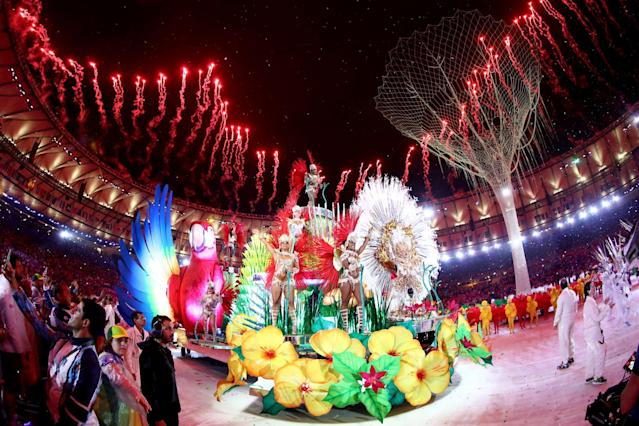 <p>Carnival singers and dancers perform as fireworks explode near the conclusion of the Closing Ceremony on Day 16 of the Rio 2016 Olympic Games at Maracana Stadium on August 21, 2016 in Rio de Janeiro, Brazil. (Photo by Ezra Shaw/Getty Images) </p>
