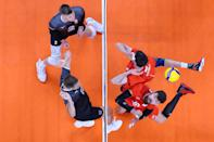 <p>Egor Kliuka #18 of Team ROC tracks the ball after the hit by Lucas van Berkel #12 of Team Canada during the Men's Quarterfinals volleyball on day eleven of the Tokyo 2020 Olympic Games at Ariake Arena on August 03, 2021 in Tokyo, Japan. (Photo by Toru Hanai/Getty Images)</p>