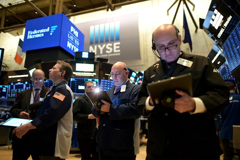 Traders work during the opening bell at the New York Stock Exchange (NYSE) on February 3, 2020 at Wall Street in New York City. - Wall Street stocks rose early Monday, bouncing after Friday's rout as markets monitored the coronavirus at the start of a week with key economic data and earnings reports. The Dow suffered the worst losses of the year on Friday as the death toll from the virus continued to climb and the ailment spread to additional countries. (Photo by Johannes EISELE / AFP) (Photo by JOHANNES EISELE/AFP via Getty Images)