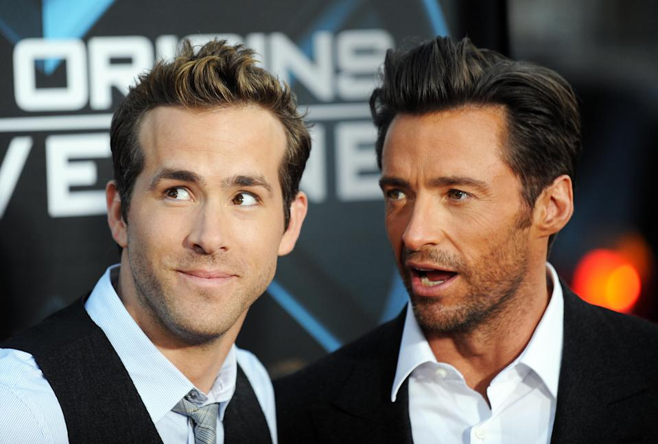 "Cast members Ryan Reynolds (R) and Hugh Jackman arrive for the Los Angeles industry screening of ""X-Men Origins-Wolverine"" at Grauman's Chinese Theater in Hollywood, California, on April 28, 2009. AFP PHOTO/Jewel SAMAD (Photo credit should read JEWEL SAMAD/AFP via Getty Images)"