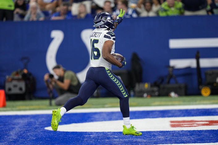 Seattle Seahawks wide receiver Tyler Lockett (16) celebrates as he scores a touchdown against the Indianapolis Colts during the first half of an NFL football game in Indianapolis, Sunday, Sept. 12, 2021. (AP Photo/AJ Mast)