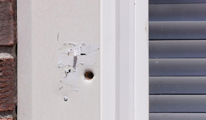 A bullet hole was still visible outside an apartment complex in Louisville, Ky. on May 25, 2020. Breonna Taylor was killed by police officers who were issuing a no-knock warrant at the apartment as she and her boyfriend slept.