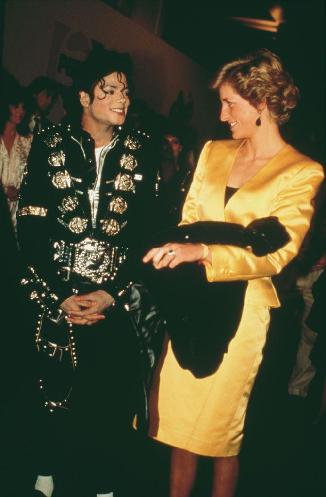 <p>Princess Diana's yellow satin suit stole the show next to Michael Jackson's gold and black jumpsuit at the singer's concert for the Prince's Trust. </p>