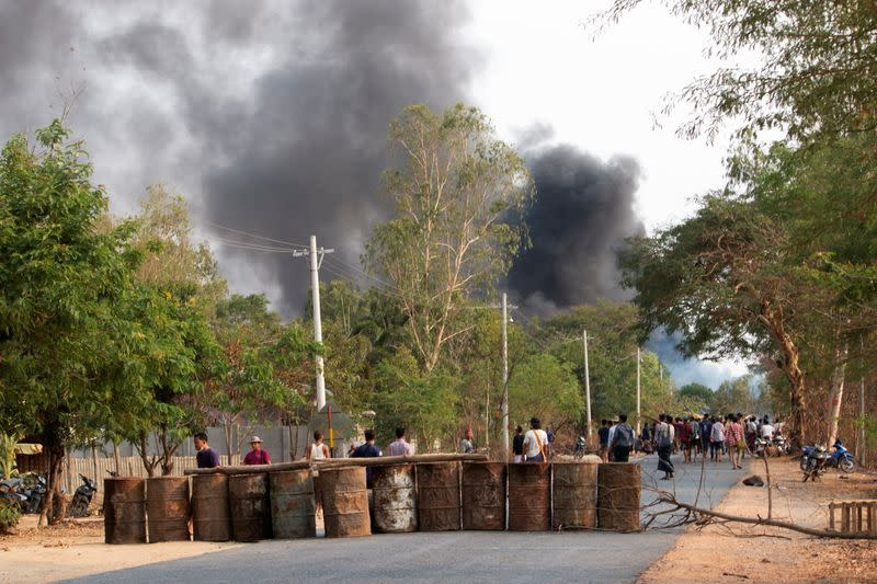 Demonstrators are seen before a clash with security forces in Taze, Myanmar
