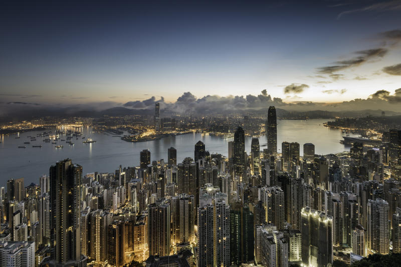 Asia, China, Hong Kong, elevated view of the skyline and victoria bay at dawn, showing the financial district