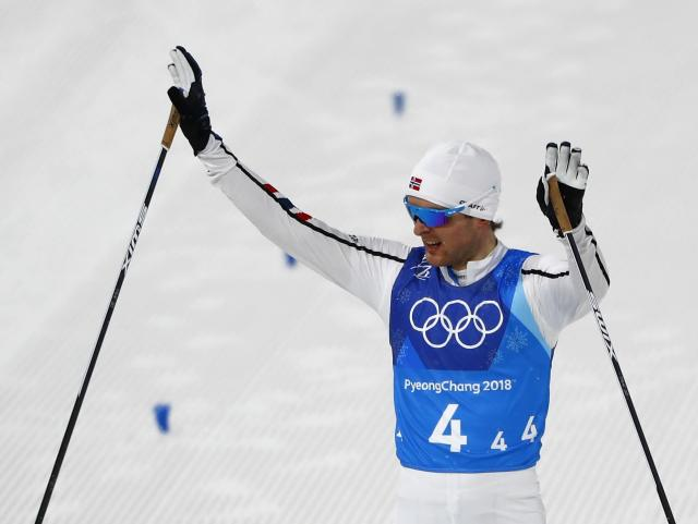 Nordic Combined Events - Pyeongchang 2018 Winter Olympics - Men's Team 4 x 5 km Final - Alpensia Cross-Country Skiing Centre - Pyeongchang, South Korea - February 22, 2018 - Joergen Graabak of Norway celebrates. REUTERS/Dominic Ebenbichler