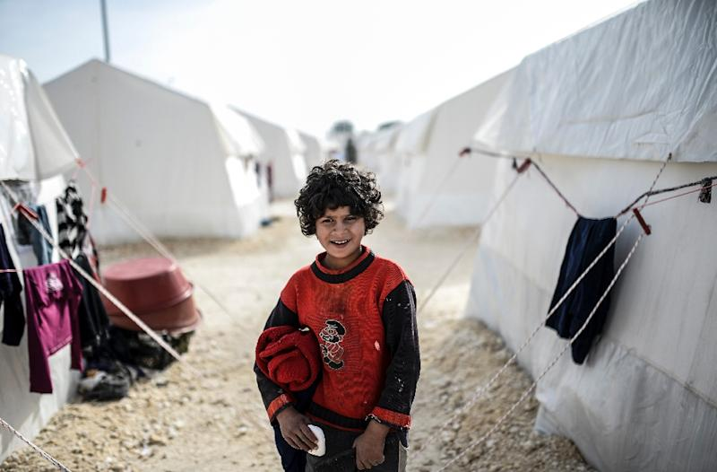 The UNHCR estimates there are currently more than 60 million people who have been forced from their homes worldwide, such as this Syrian Kurdish girl in Sanliurfa, Turkey