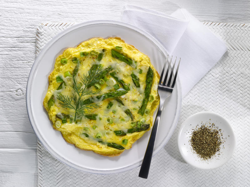 A quick, easy and delicious way to serve asparagus is in an omelette with cheese, spring onions and your choice of additional veg or meat. (Getty Images)