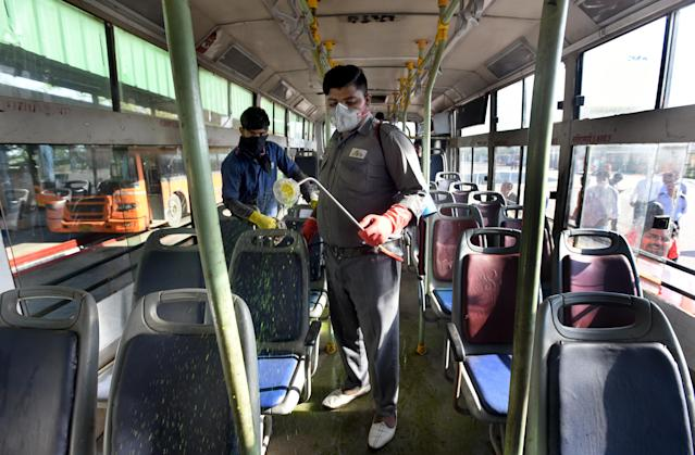 Delhi Transport Corporation (DTC) cleaning staff chemically disinfect a bus as a precautionary measure against the spread of coronavirus.