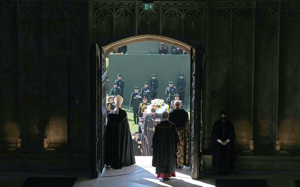 The coffin of the Duke of Edinburgh is carried into his funeral service at St George's Chapel at Windsor Castle - Danny Lawson