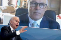President Joe Biden speaks with Washington Gov. Jay Inslee via teleconference during a meeting with governors to discuss ongoing efforts to strengthen wildfire prevention, preparedness and response efforts, and hear firsthand about the ongoing impacts of the 2021 wildfire season in the South Court Auditorium in the Eisenhower Executive Office Building on the White House Campus in Washington, Friday, July 30, 2021. (AP Photo/Andrew Harnik)