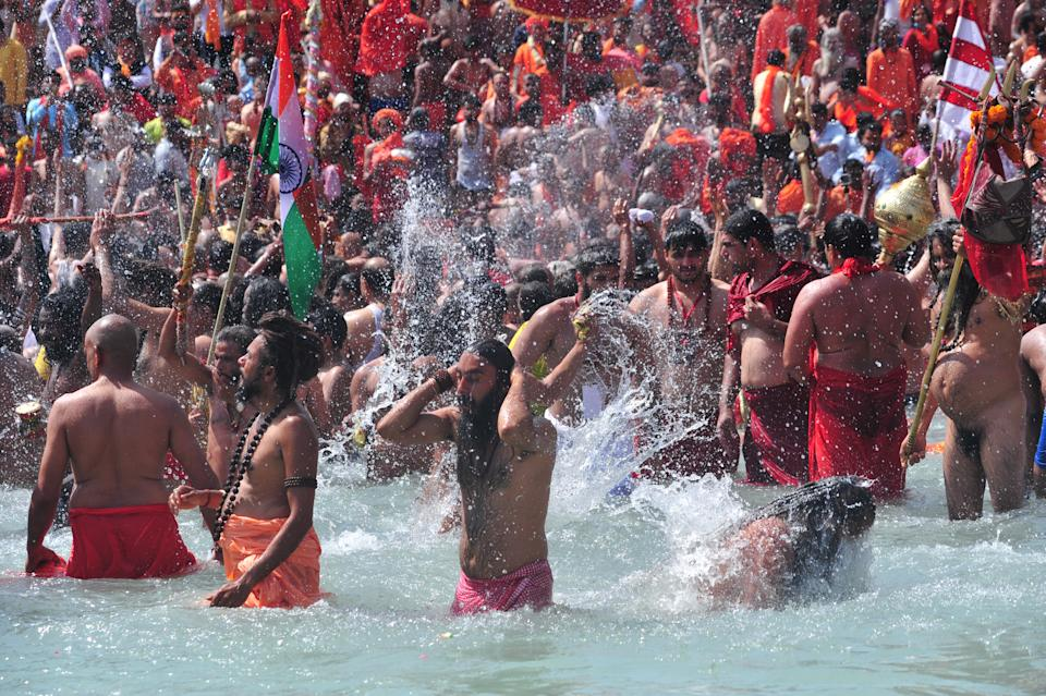Naga Sadhus or holy man of Niranjani Akhara take a holy dip in Ganges River on the occasion of first royal bath of Shivratri festival during Maha Kumbh Festival , in Haridwar on March 11, 2021 . (Photo by Ritesh Shukla/NurPhoto via Getty Images)